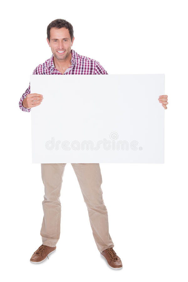 Portrait Of Young Man Holding Placard Stock Image