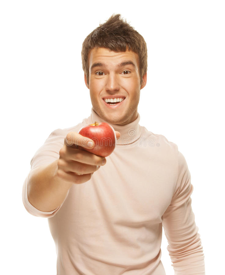 Portrait of young man holding red apple stock photos