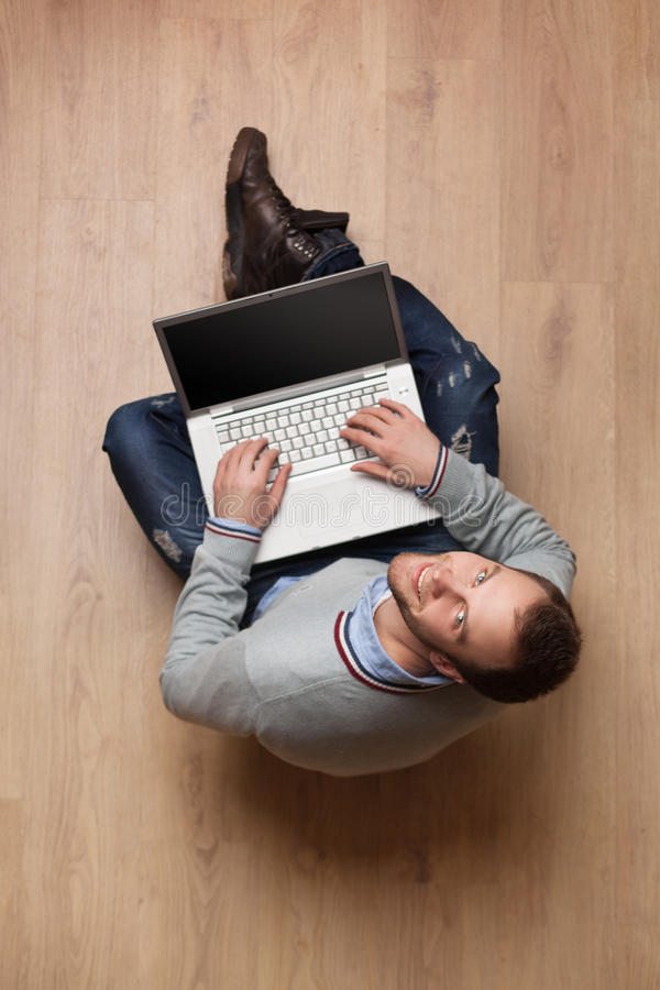 Portrait of young man with laptop stock photos