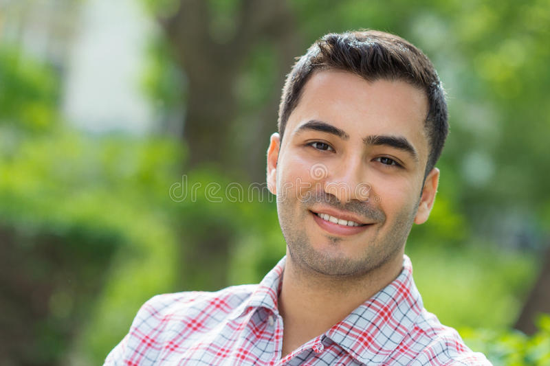 Portrait of a young man. Portrait of a laughing young man. Close up outside shot of happy gorgeous guy stock photos