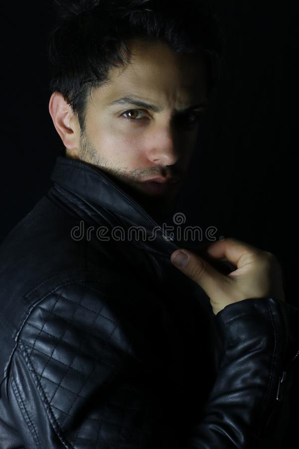 Portrait of a young man with leather jacket royalty free stock image