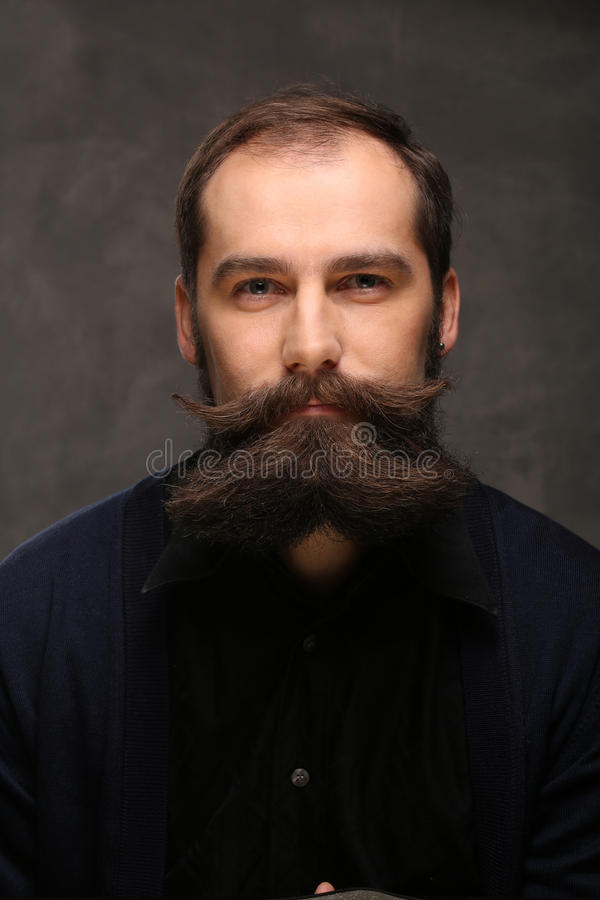 Portrait young man with long beard and mustache hipster royalty free stock images