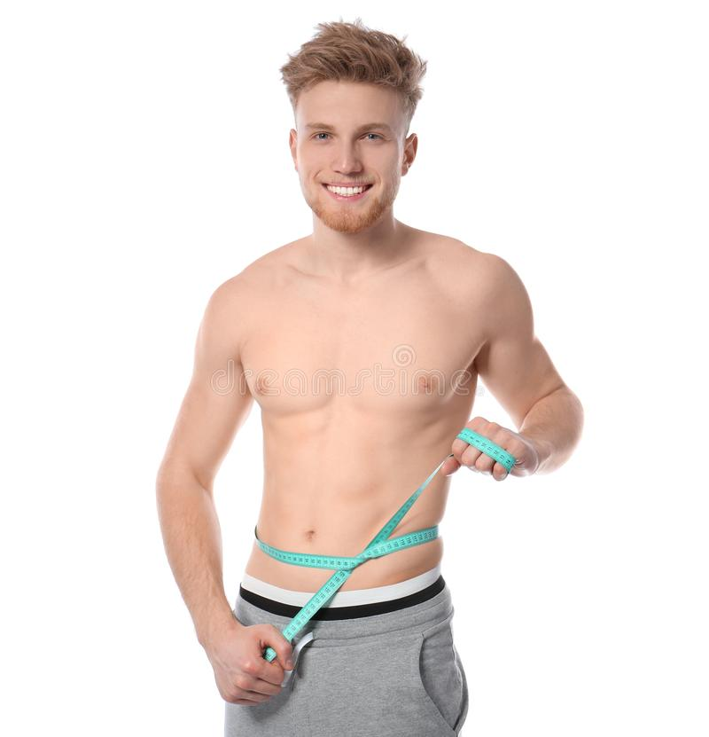 Portrait of young man with measuring tape showing his slim body stock photos