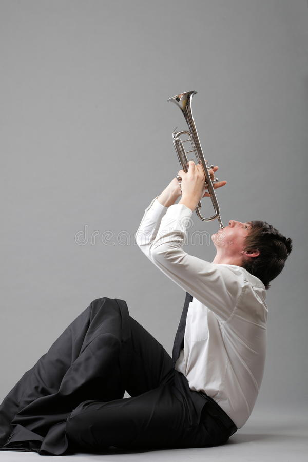 Download Portrait Of A Young Man Playing His Trumpet Stock Photo - Image: 27316316