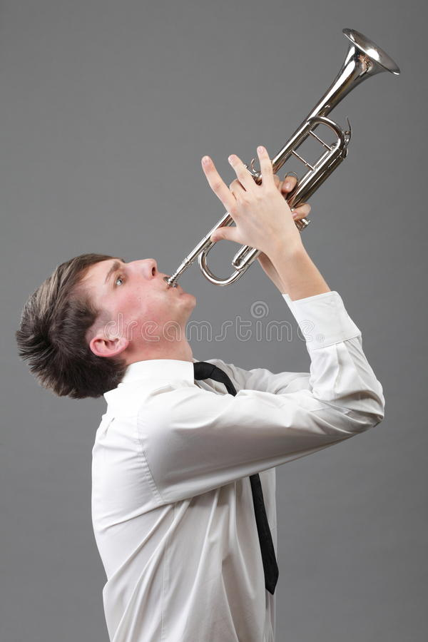 Download Portrait Of A Young Man Playing His Trumpet Stock Image - Image: 27338593