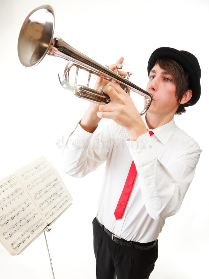 Download Portrait Of A Young Man Playing His Trumpet Stock Photo - Image: 27338946