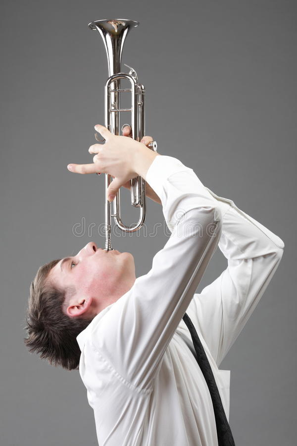 Download Portrait Of A Young Man Playing His Trumpet Stock Photo - Image: 33542902