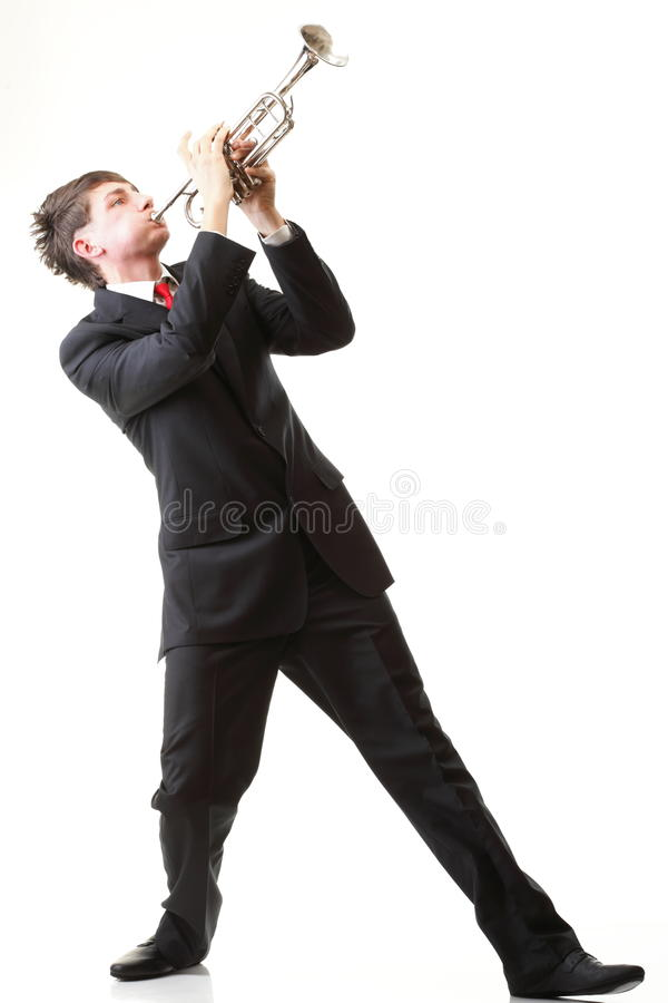 Portrait Of A Young Man Playing His Trumpet Royalty Free Stock Photo