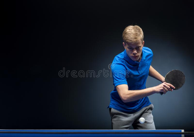 Portrait of young man playing tennis stock images