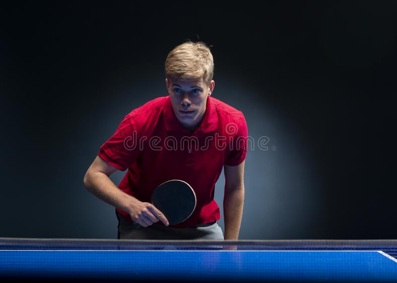 Portrait of young man playing tennis stock photos
