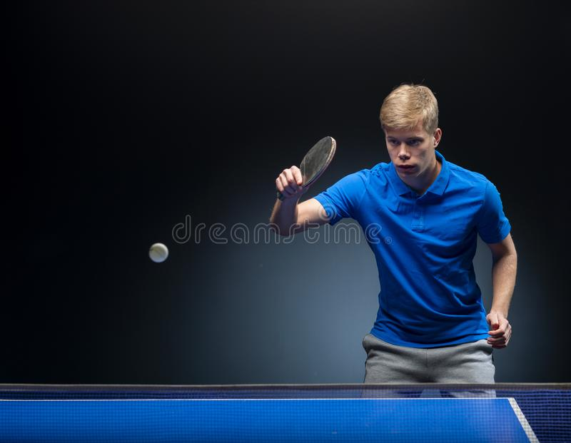 Portrait of young man playing tennis stock image
