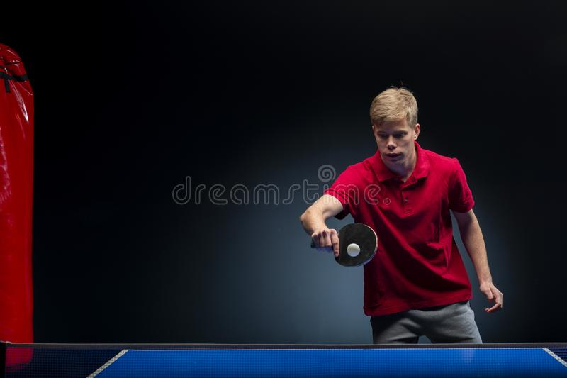 Portrait of young man playing tennis royalty free stock photo
