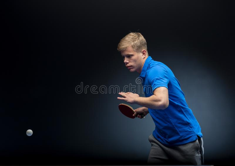 Portrait of young man playing tennis stock photo