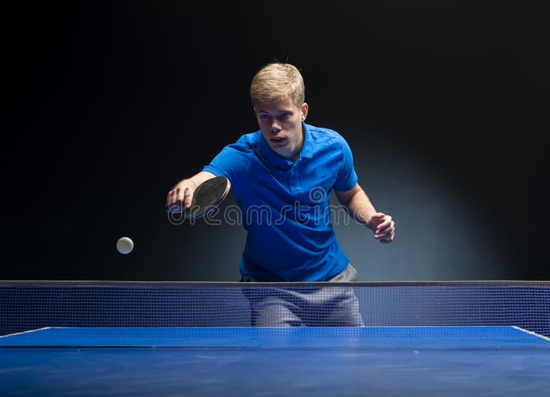 Portrait of young man playing tennis royalty free stock photography