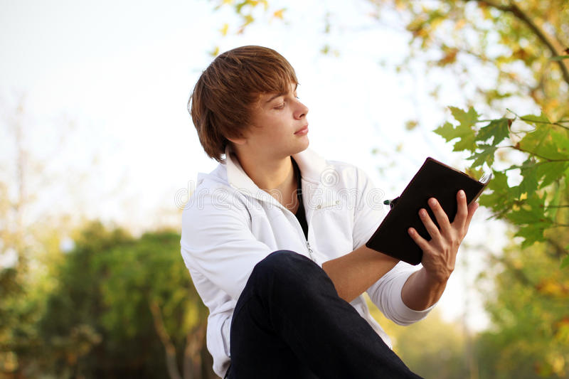 Portrait of young man read the book, royalty free stock photo
