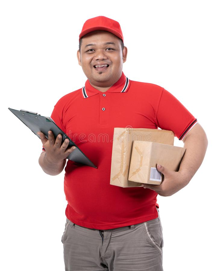 Portrait of young man with red uniform delivering boxes and holding clipboards stock images
