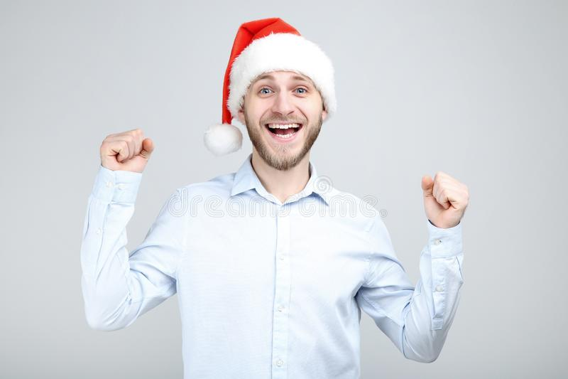 Portrait of young man with santa hat royalty free stock images