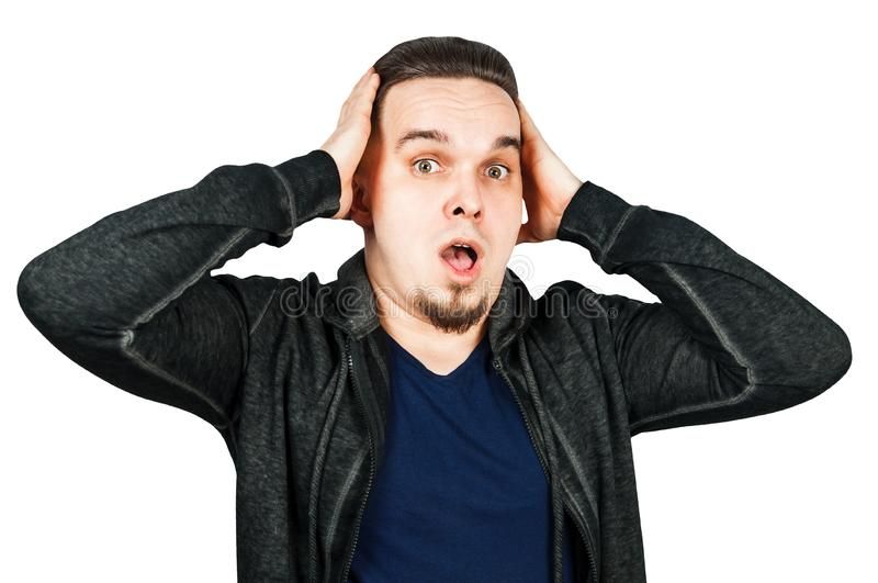 Portrait of young man scared, hold hand head and open mouth. Man isolated on white background stock photo