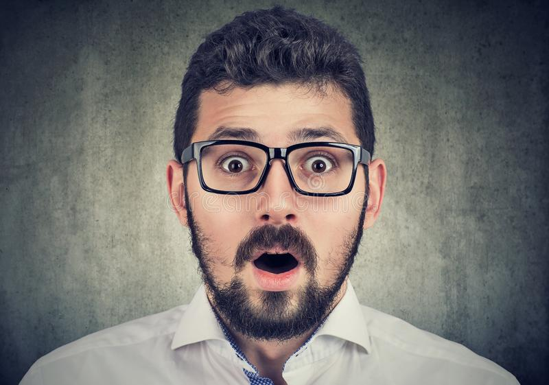 Portrait of young man with shocked face expression stock image