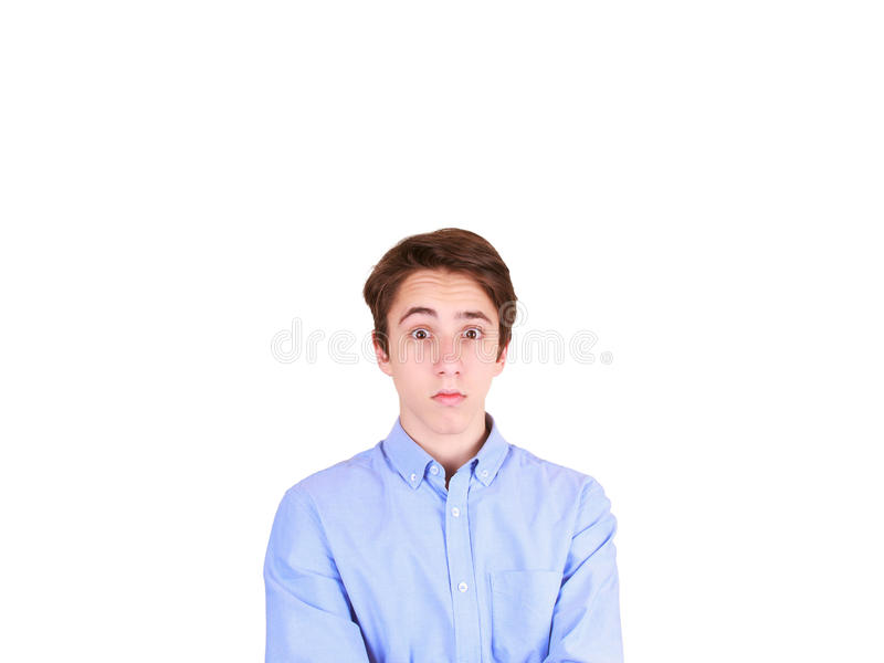Portrait of young man with shocked facial expression. Portrait of surprised teenager royalty free stock image