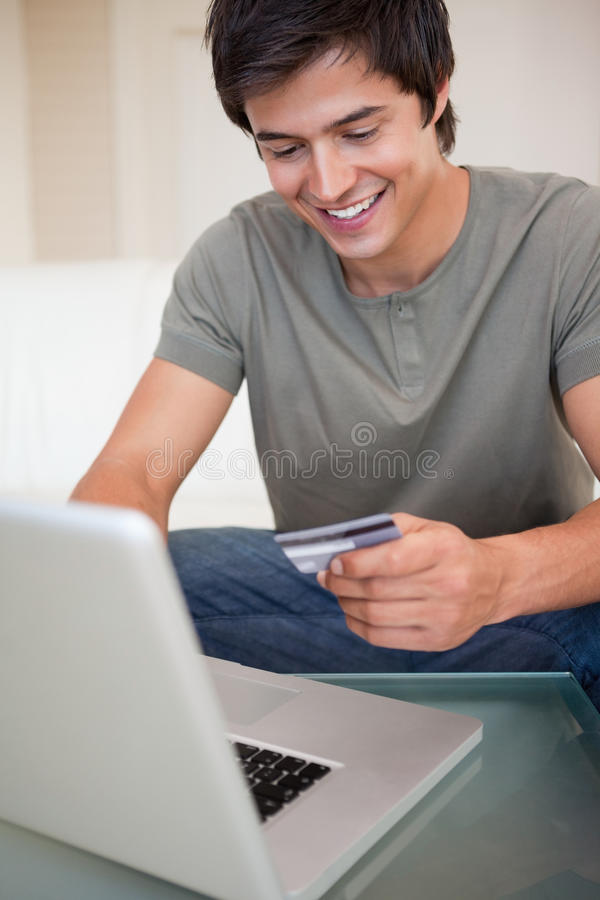 Portrait of a young man shopping online royalty free stock photo