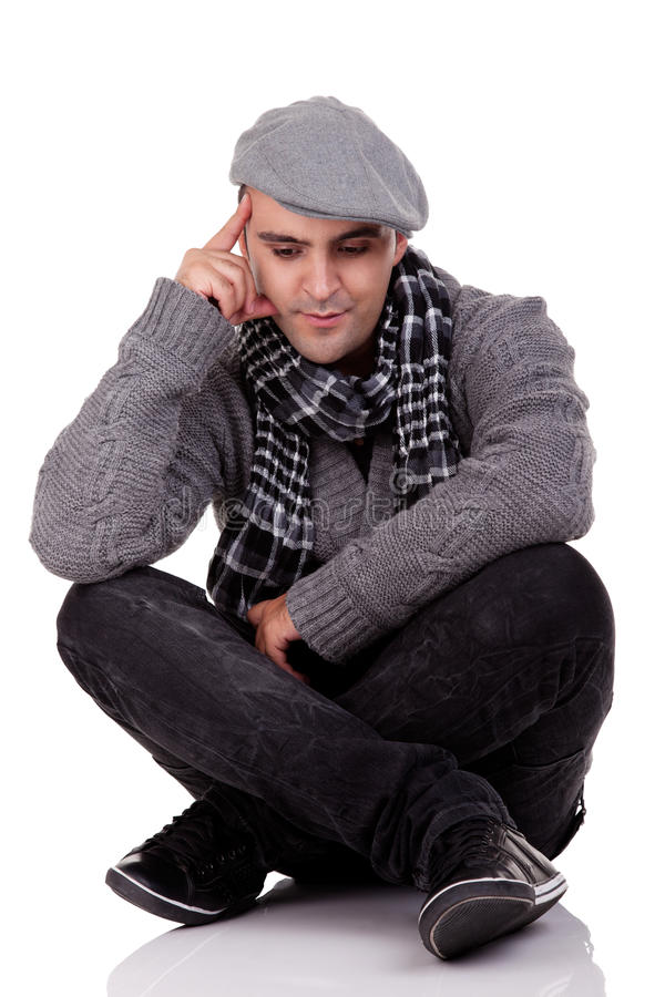 Portrait of a young man sitting on the floor stock image