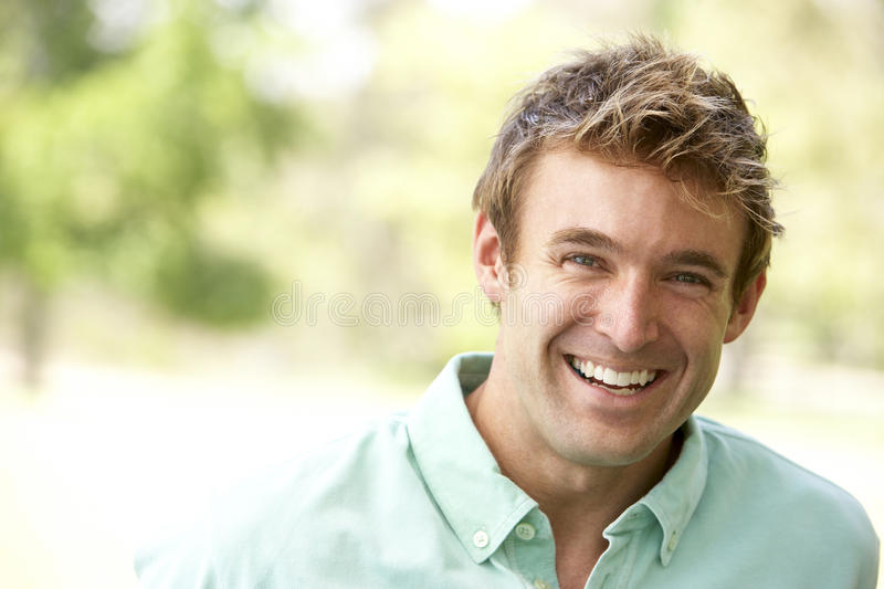 Portrait Of Young Man Sitting In Park royalty free stock photos