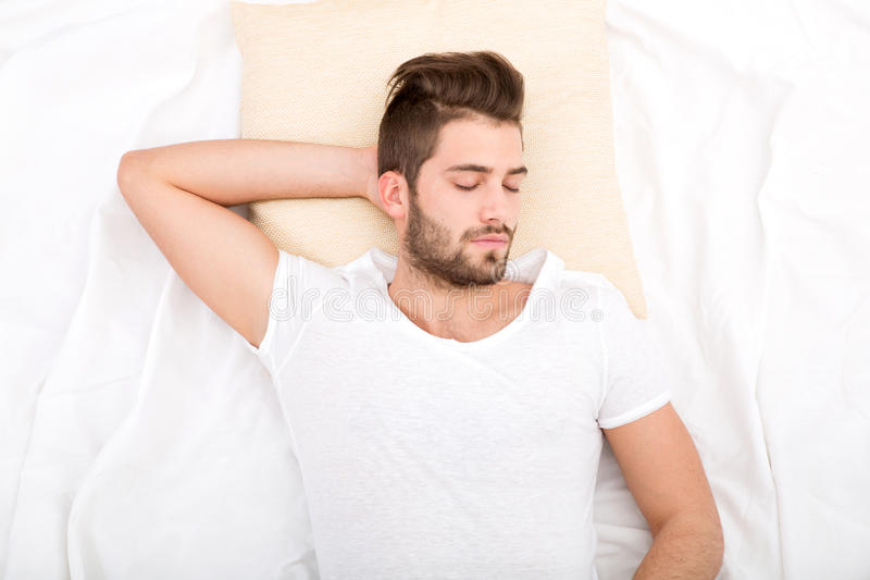 Portrait of young man sleeping royalty free stock photography