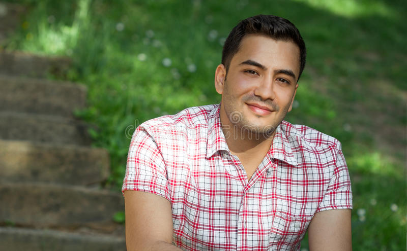 Portrait of a young man. Portrait of a smile young man. Close up outside shot of happy gorgeous guy stock photo