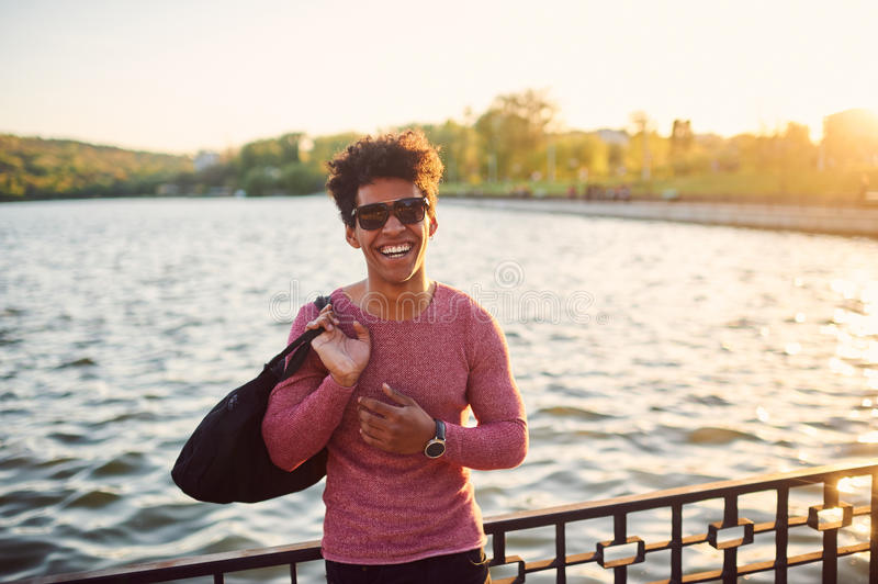Portrait of young man smiling outside stock images