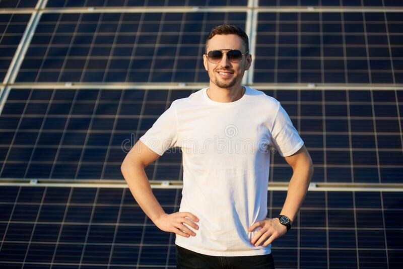 Portrait of a young man by solar panels royalty free stock image