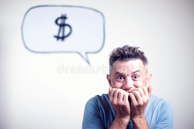 Portrait of a young man with a speech bubble dollar singe over h. Is head stock image