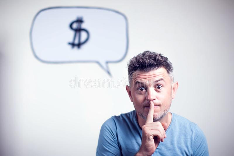 Portrait of a young man with a speech bubble dollar singe over h. Is head isolated stock photography
