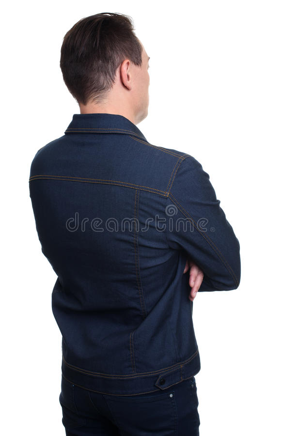Portrait of young man in studio, back view royalty free stock photos