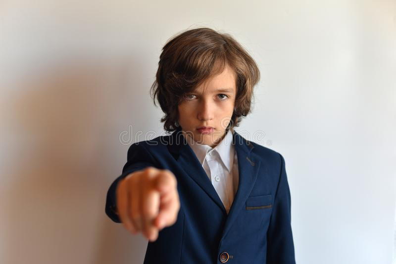 Portrait of a young man in a suit with an outstretched hand. stock image