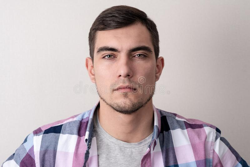 Portrait of young man with suspicious channels royalty free stock image