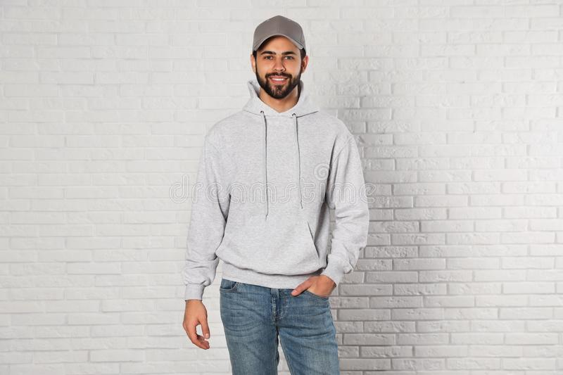 Portrait of young man in sweater. Mock up for design stock photos