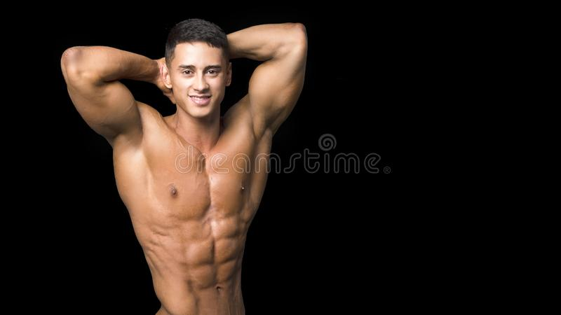 Portrait of young man with torso naked with jeans on black background stock photos