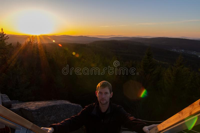 Portrait of young man walk up on stair with sunset, Austria landscape stock images