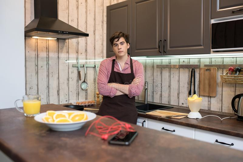 Young Man in Kitchen stock images