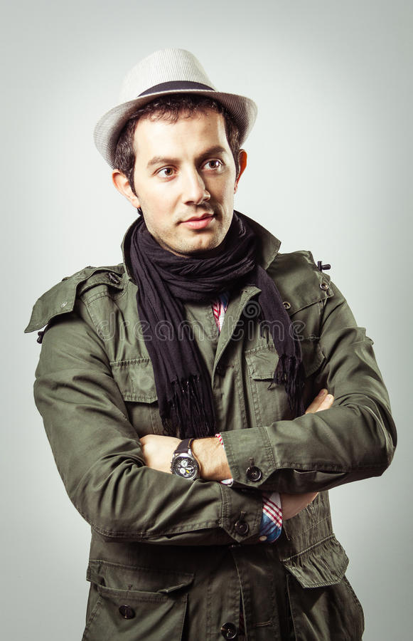 Portrait of young man wearing hat and scarf stock image