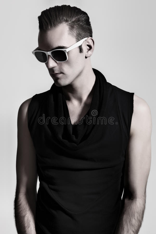 Portrait of a young man wearing tinted sunglasses royalty free stock image