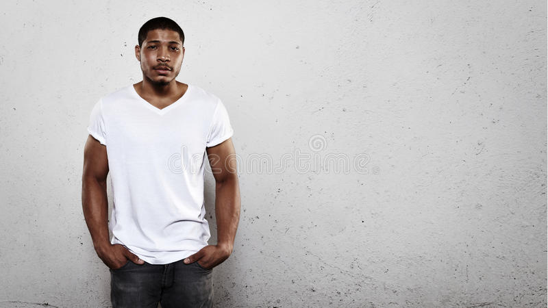 Portrait of a young man wearing white t-shirt stock images