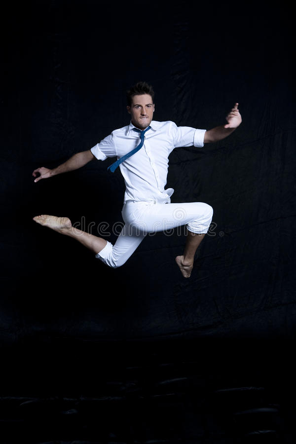Download Portrait Of Young Man In White Jumping Gracefully Stock Photo - Image: 13175156