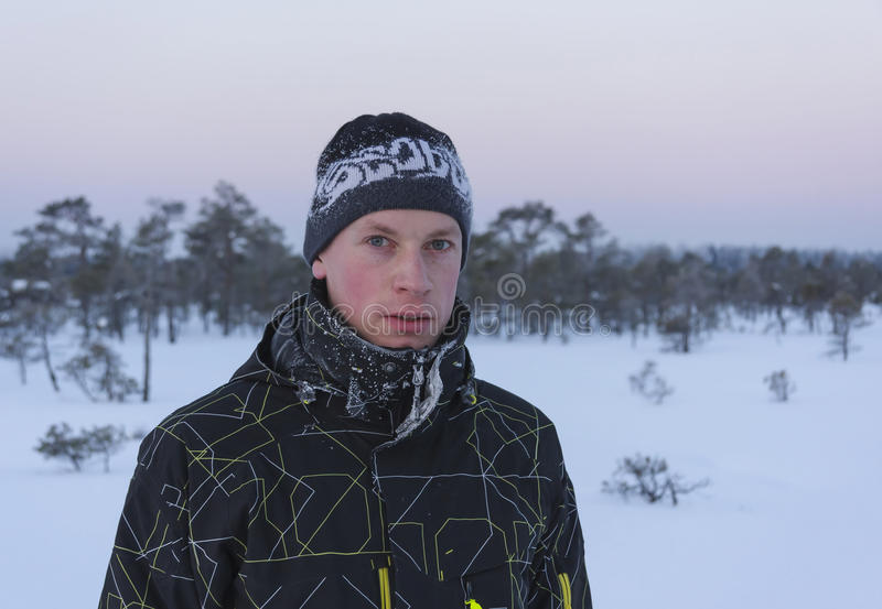 Portrait of a young man at winter royalty free stock image