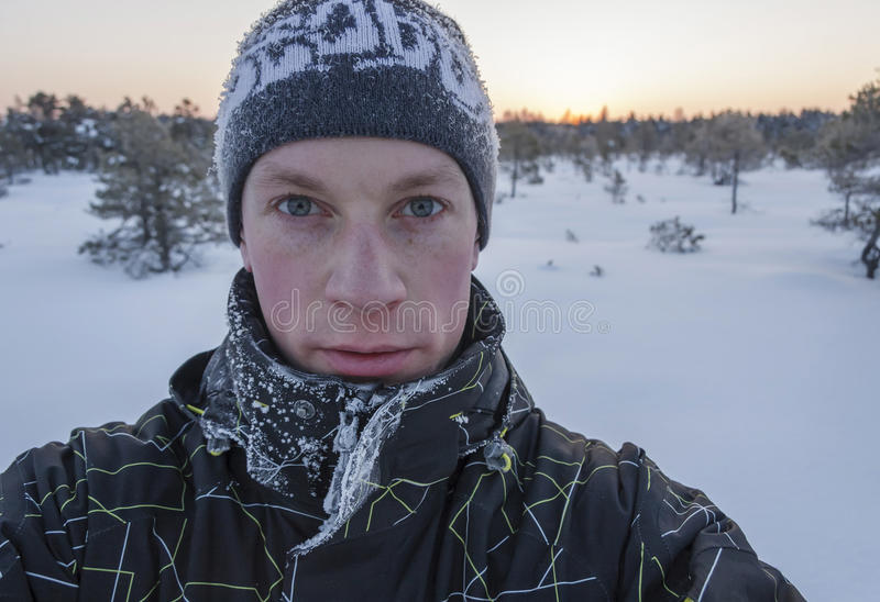Portrait of a young man at winter stock photography
