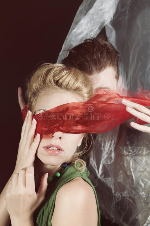 Portrait of young man and woman blindfolded royalty free stock images