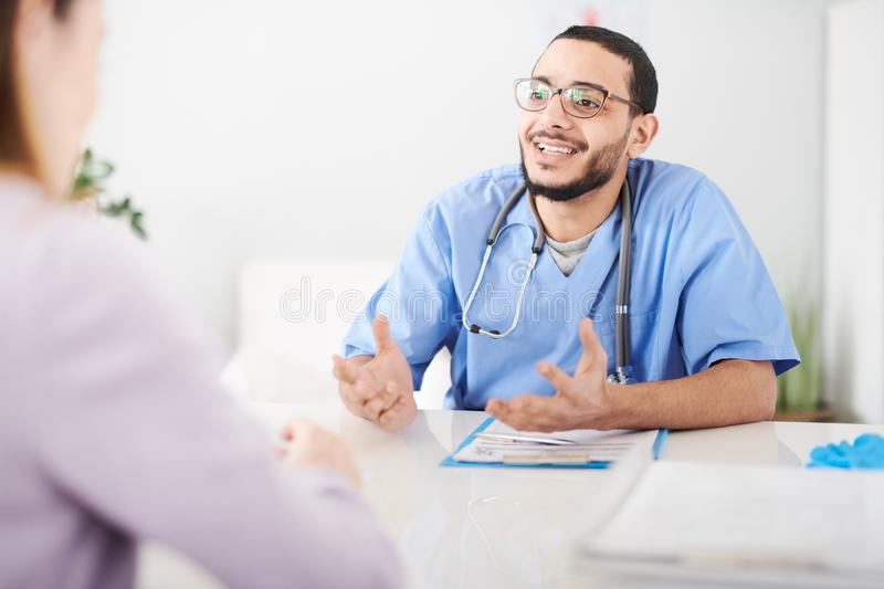 Middle-Eastern Doctor Consulting Patient stock image