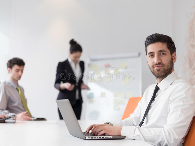 Portrait of young modern arab business man at office. Portrait of young modern arab business men with beard at office, group of business people on meeting making royalty free stock photography