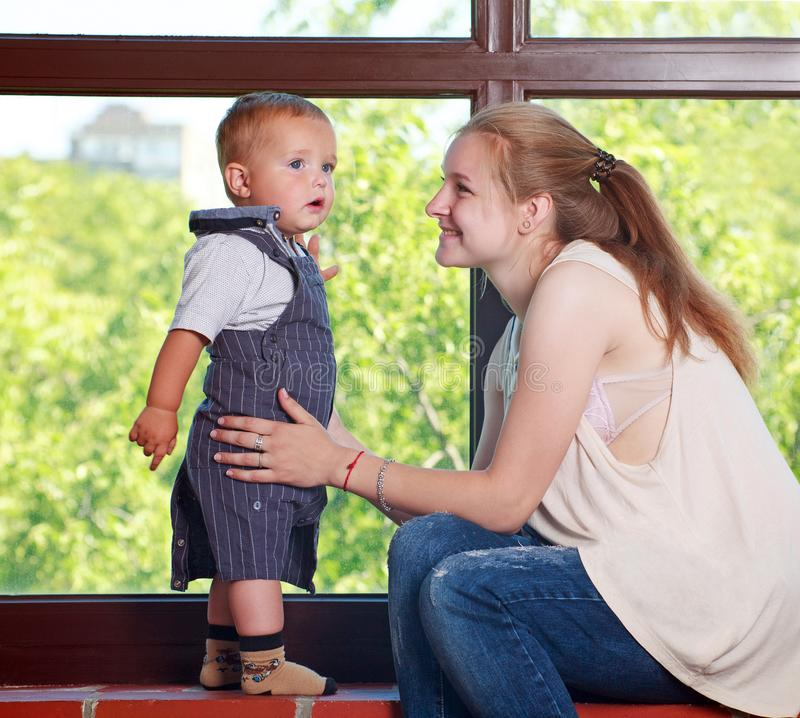 Portrait young mother girl and baby son happy together at home stock photo